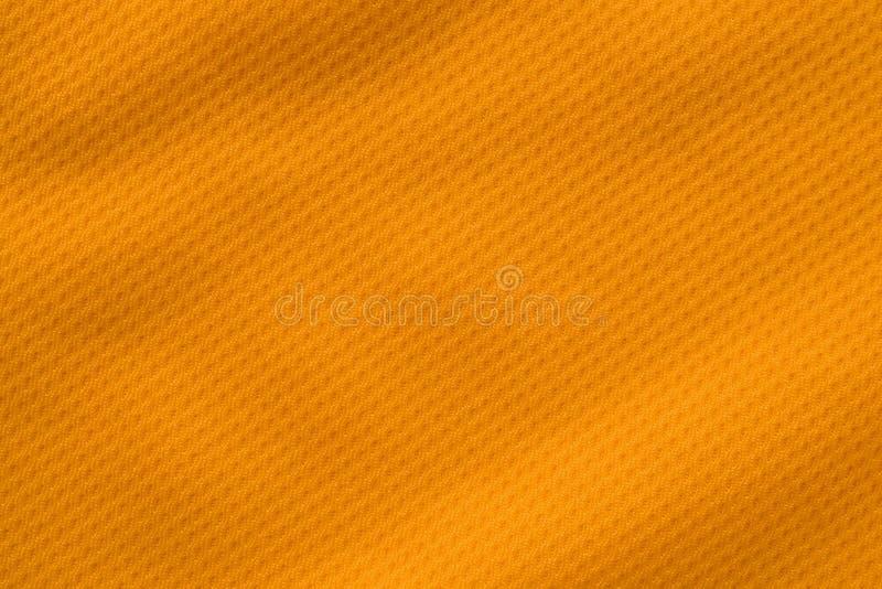 Oranje kleurensporten die van het de voetbaloverhemd van stoffenjersey de textuur hoogste mening kleden stock foto