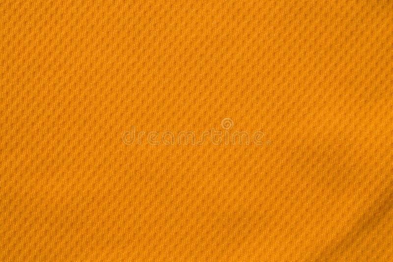 Oranje kleurensporten die van het de voetbaloverhemd van stoffenjersey de textuur hoogste mening kleden stock foto's