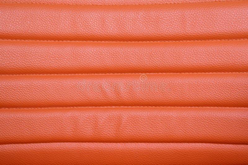 Oranje leerachtergrond stock afbeelding