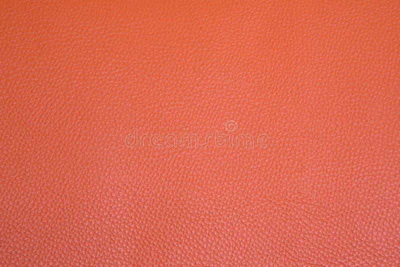 Oranje leerachtergrond stock fotografie