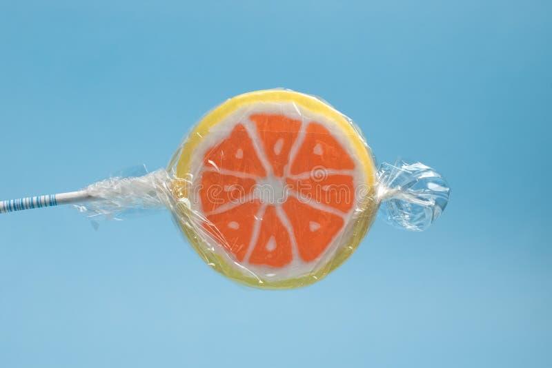 Oranje lolly royalty-vrije stock afbeelding