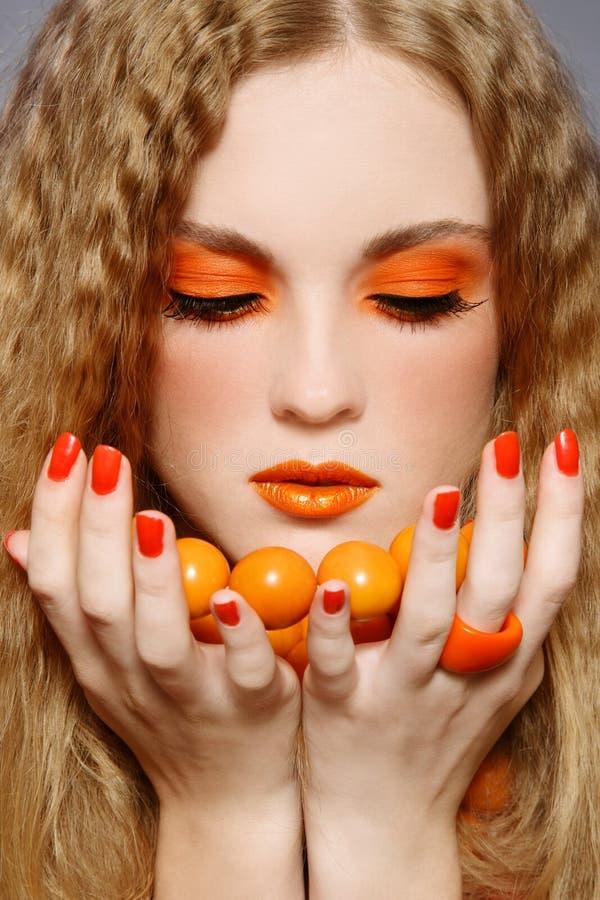 Oranje make-up stock afbeeldingen