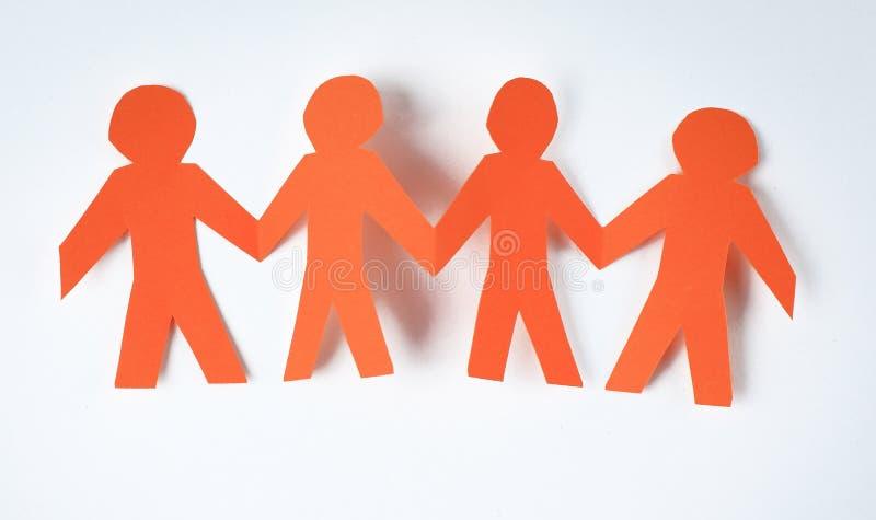 Oranje mens vier op een document achtergrond stock foto's