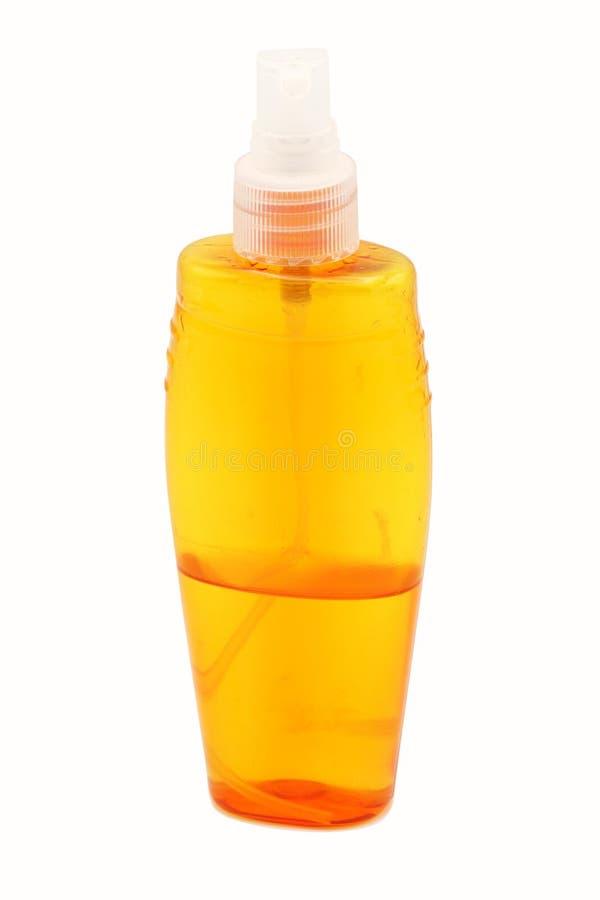 Oranje nevelfles op een witte achtergrond lay-out stock afbeelding