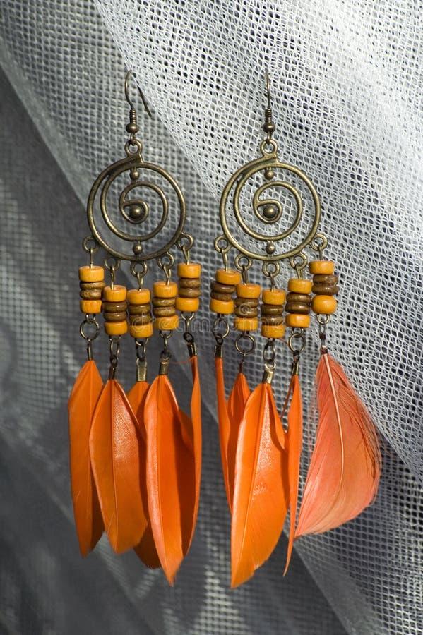 Oranje oorringen stock fotografie