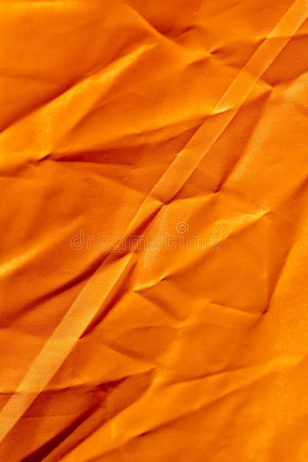 Oranje polyester macro abstracte fijne kunst als achtergrond in hoogte - de producten van kwaliteitsdrukken royalty-vrije stock fotografie