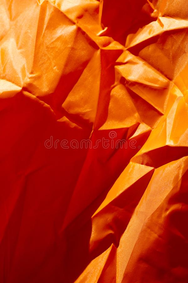 Oranje polyester macro abstracte fijne kunst als achtergrond in hoogte - de producten van kwaliteitsdrukken stock foto