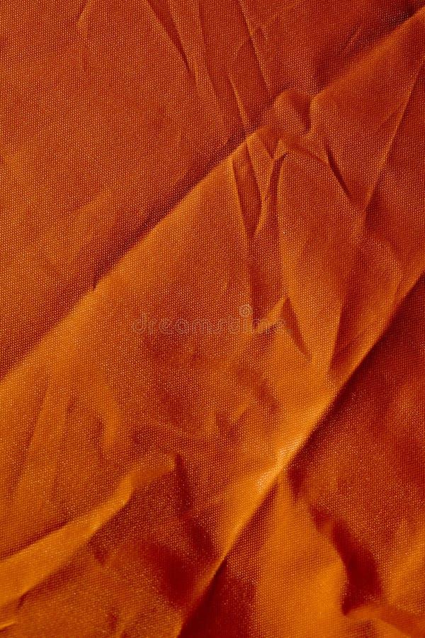 Oranje polyester macro abstracte fijne kunst als achtergrond in hoogte - de producten van kwaliteitsdrukken stock afbeelding