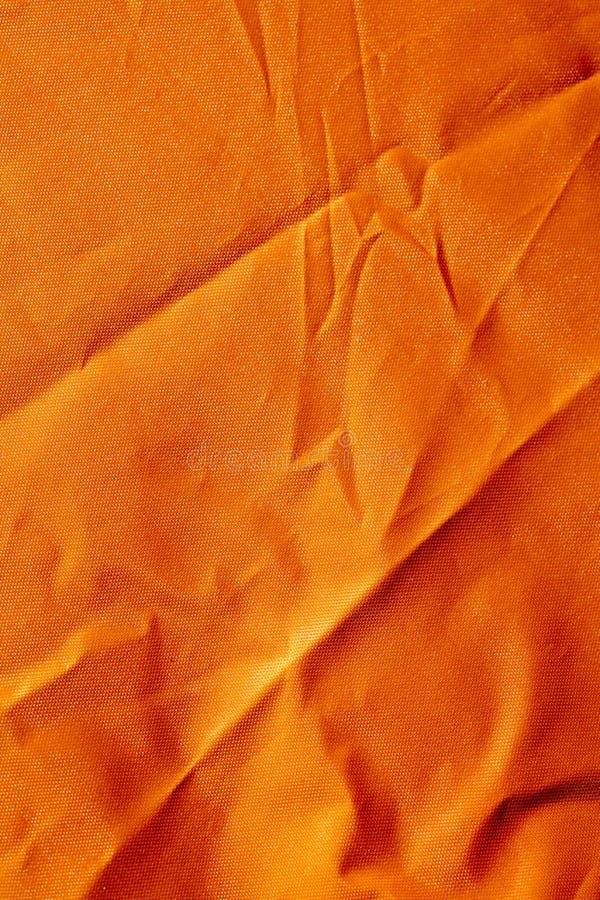 Oranje polyester macro abstracte fijne kunst als achtergrond in hoogte - de producten van kwaliteitsdrukken stock afbeeldingen