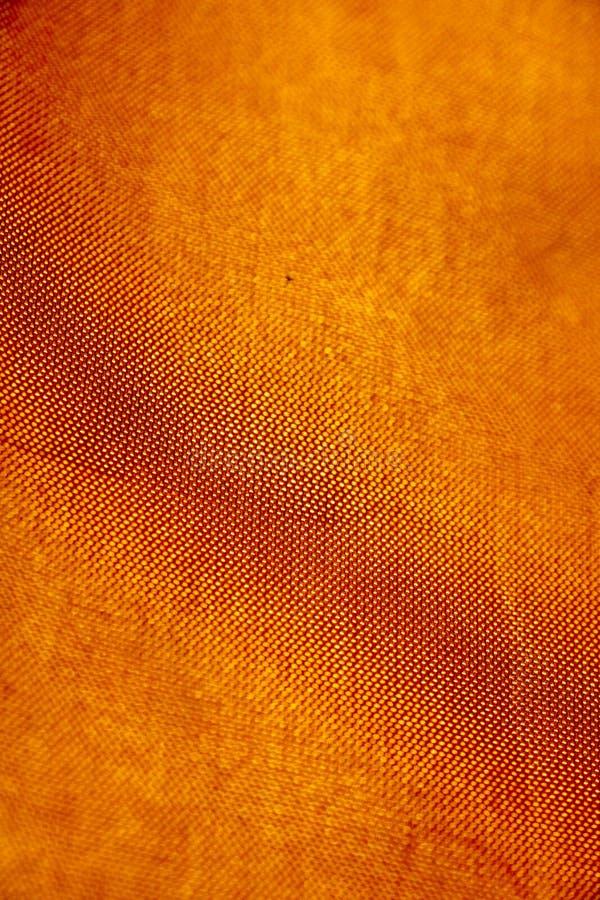 Oranje polyester macro abstracte fijne kunst als achtergrond in hoogte - de producten van kwaliteitsdrukken stock fotografie