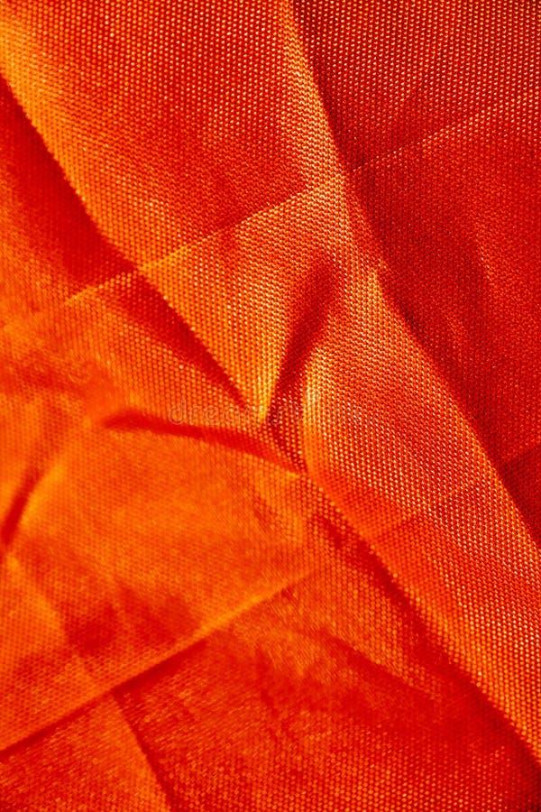 Oranje polyester macro abstracte fijne kunst als achtergrond in hoogte - de producten van kwaliteitsdrukken royalty-vrije stock afbeeldingen