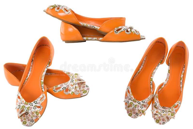 Oranje schoenen voor meisje stock foto's