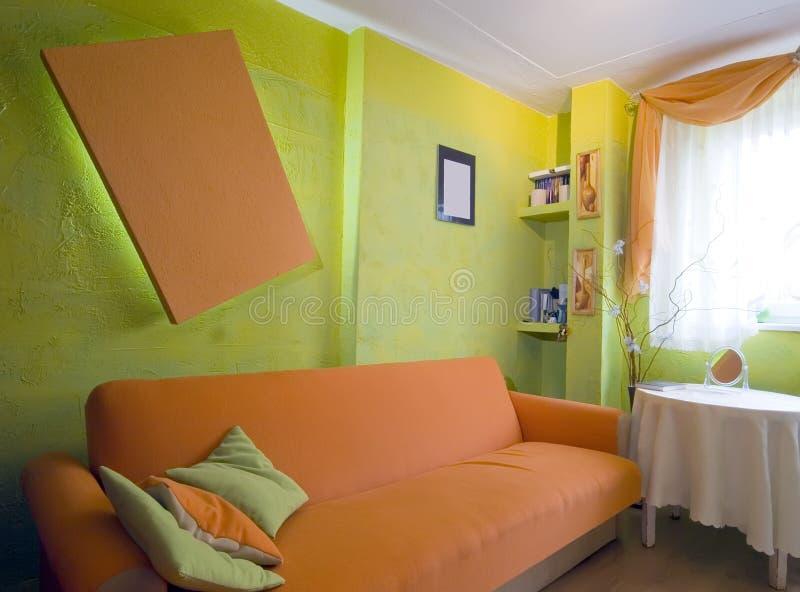 Oranje slaapkamer royalty-vrije stock foto