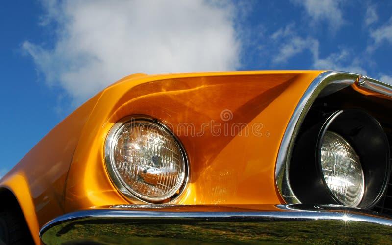Oranje spier stock foto