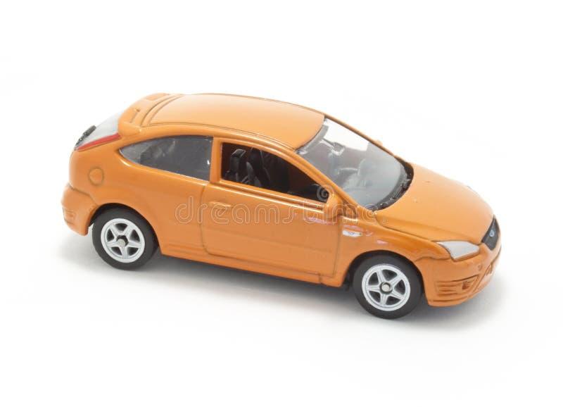 Oranje stuk speelgoed auto  stock fotografie