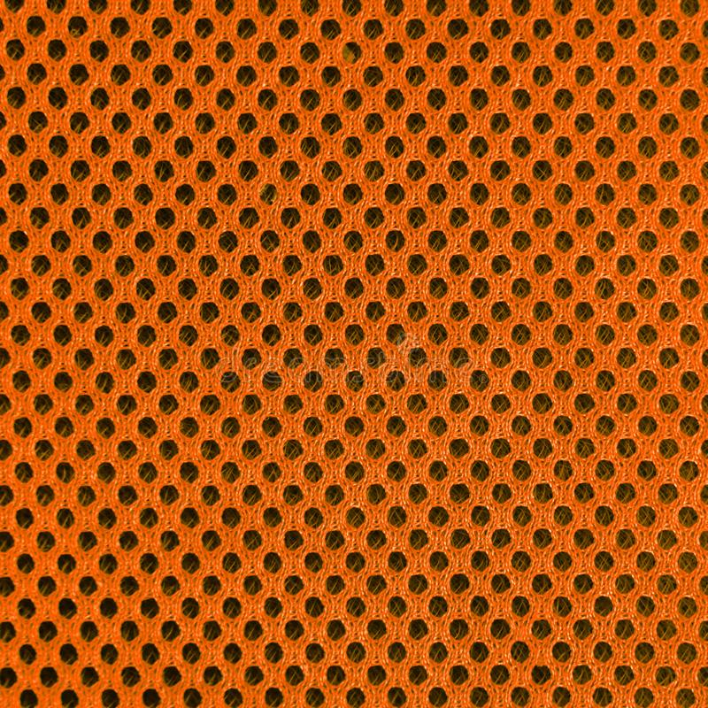 Oranje in te ademen poreus poriferous materiaal voor luchtventilatie met gaten Sportkledings materiële nylon textuur vierkant royalty-vrije stock afbeeldingen