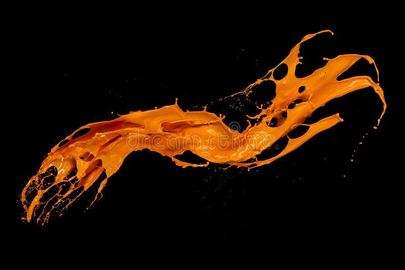 Oranje verfplons op zwarte achtergrond royalty-vrije stock afbeeldingen