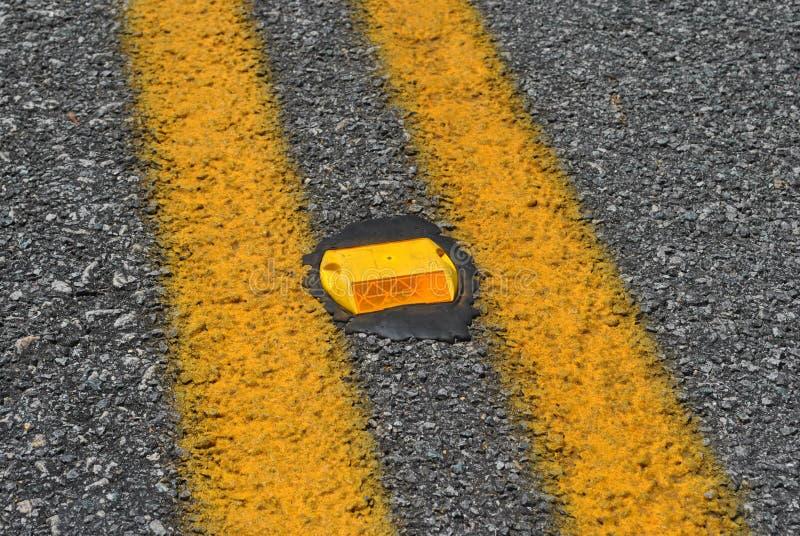 Oranje wegreflector stock foto's