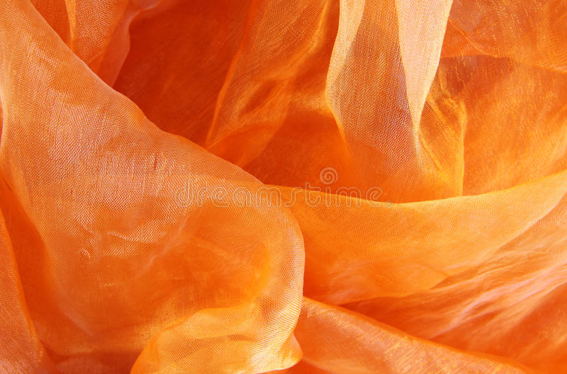 Oranje zijdetextuur stock afbeeldingen