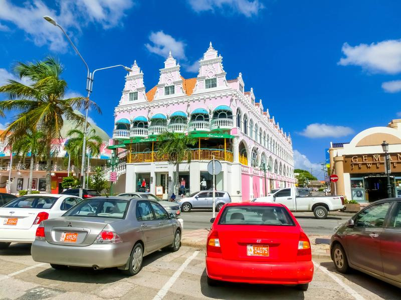 Oranjestad, Aruba - December 4, 2019: Street view of busy tourist shopping district in Caribbean city royalty free stock photos