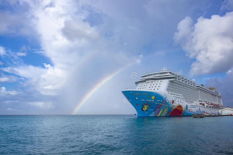 A Colorful Cruise Ship Called Norwegian Breakaway, NCL, Docked at Oranjestad Harbor stock photos