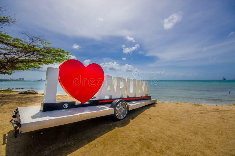 ORANJESTAD, ARUBA - NOVEMBER 05, 2015: I love sign. ORANJESTAD, ARUBA - NOVEMBER 05, 2015: I loveAruba sign used for tourism near the beach stock photos