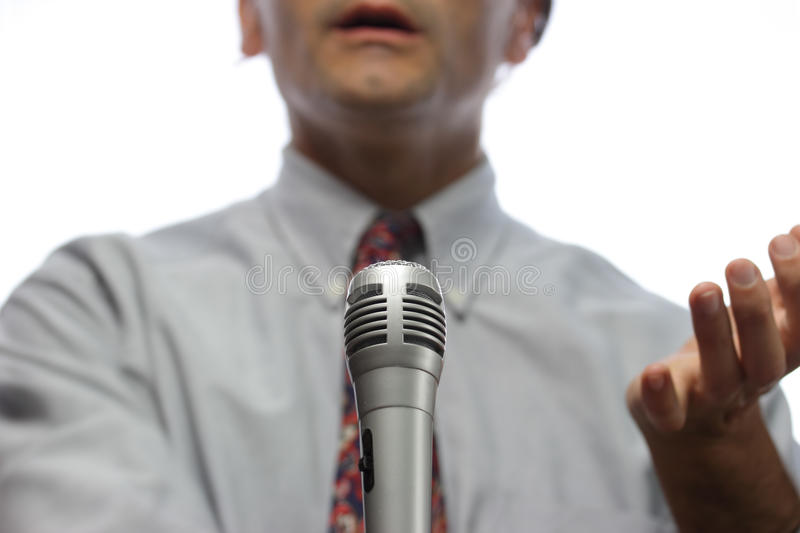 Orator. Microphone and out of focus Public speaker