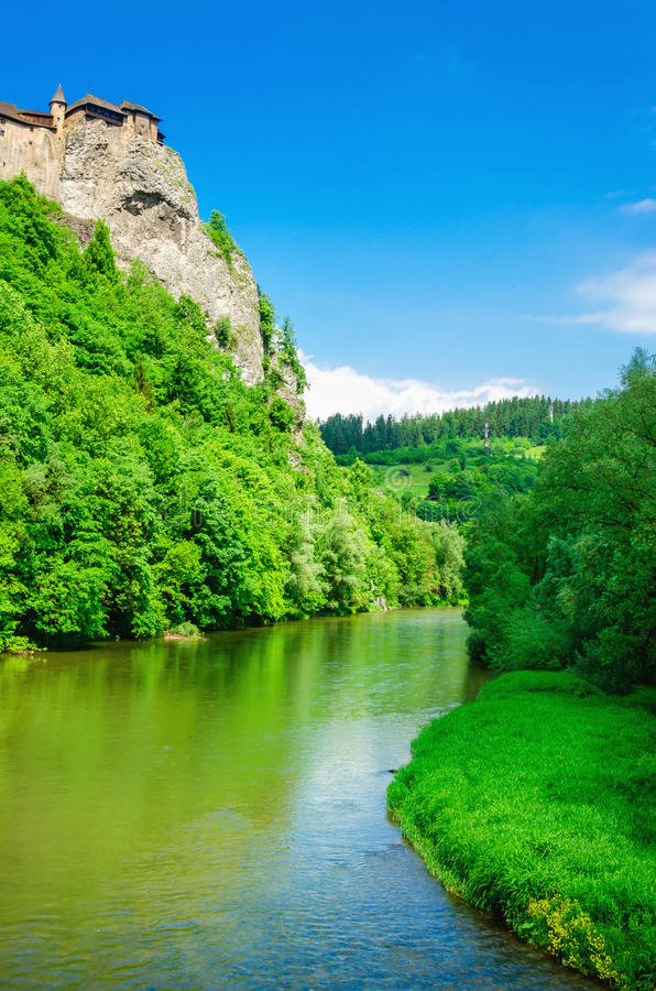 Orava Castle, river and blue sky, Slovakia. Orava Castle on a background of green trees, river and blue sky, one of the most beautiful Slovak castles, Orava royalty free stock photography