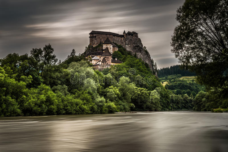 Orava Castle in Slovakia after storm. Orava Castle viewed from the village Oravsky Podzamok after storm. Long exposure royalty free stock images