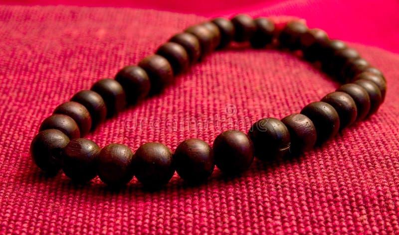 Orayer perle en bois images stock