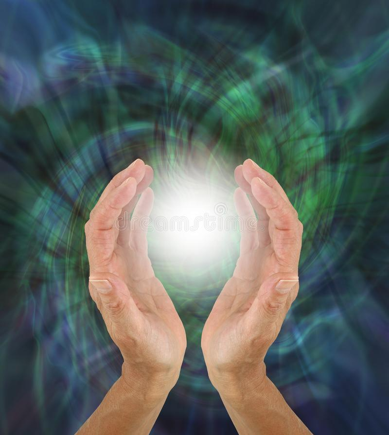 Orb Light Paranormal Phenomenon between hands royalty free stock photography