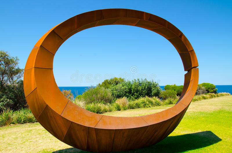 ` Orb ` is a sculptural artwork by David Ball at the Sculpture by the Sea annual events free to the public sculpture exhibition. SYDNEY, AUSTRALIA. – On royalty free stock photography