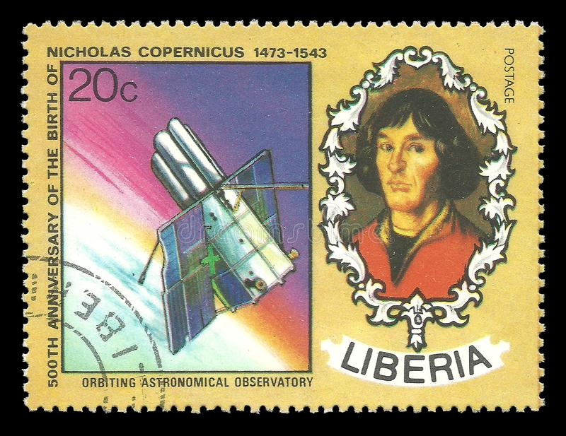 Orbiting Astronomical Observatory. Liberia - CIRCA 1973: Stamp printed by Liberia, Color memorable edition devoted 500th Anniversary of the Birth of Nicholas stock images