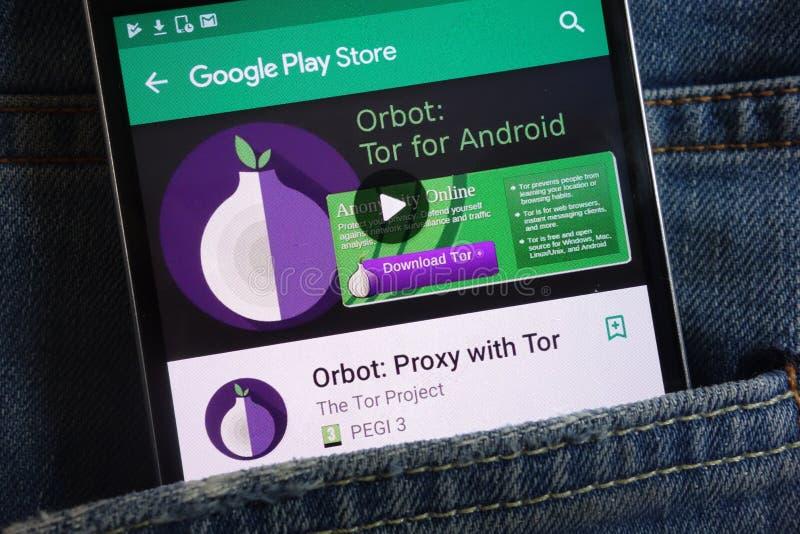 Orbot: Полномочие с приложением скалистой вершины на вебсайте магазина игры Google показанном на смартфоне спрятанном в кармане д стоковая фотография