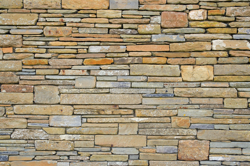 Orcadian wall. Typical Orkney wall built using local sandstone stock photo