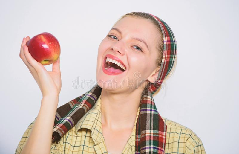 Orchard, gardener girl with apple basket. farming concept. healthy teeth. vitamin and dieting food. Happy woman eating. Apple. spring harvest. summer fruit royalty free stock photos