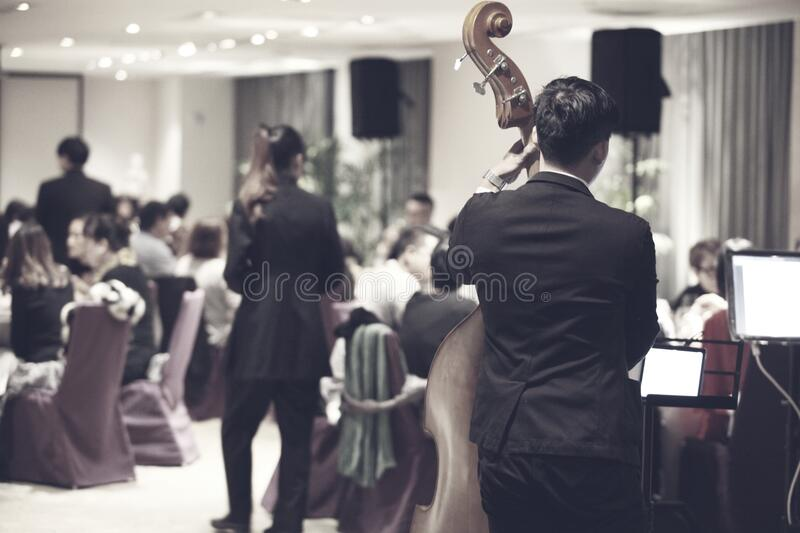 Orchestra playing in restaurant stock image