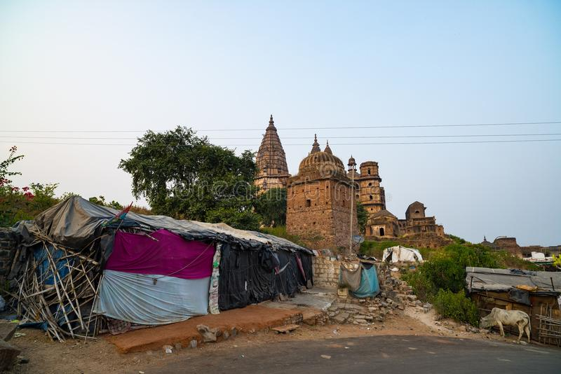 Orchha cityscape, hindu Chaturbhuj temple, Madhya Pradesh, India. Slum in the foreground stock photography