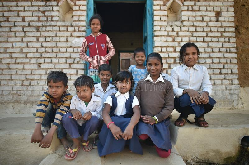 Orchha, India, November 28, 2017: Group of kids posing outside home. In the outskirt of Orchha stock photos