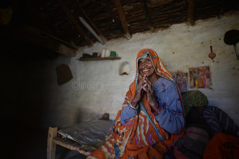 Orchha, India, November 28, 2017: Old woman sitting in her bed. In house stock photos