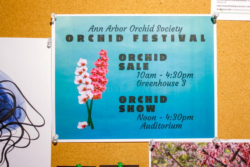 Orchid Festival event flier pinned on bulletin board. Full color printed flier advertising the special event who, what, where and when royalty free stock images