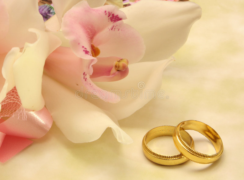 Orchid and Wedding Rings royalty free stock image