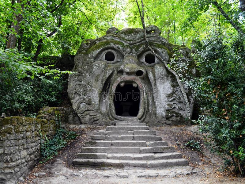 Orcus mouth. In Parco dei Mostri (Park of the Monsters), in Bomarzo (Viterbo, Italy). The gardens are a Manieristic monumental complex created during the 16th royalty free stock photos