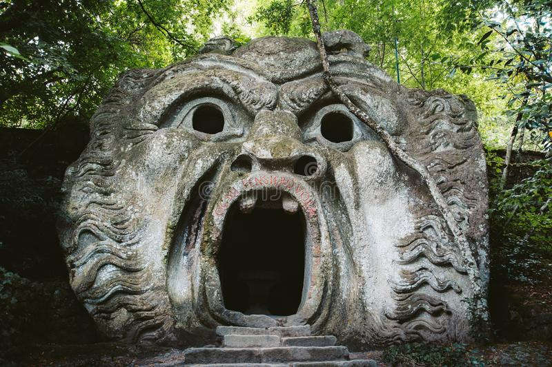Parco dei Mostri Park of the Monsters in Bomarzo, province of Viterbo, Lazio, Italy. Orcus mouth sculpture at famous Parco dei Mostri Park of the Monsters, also royalty free stock images