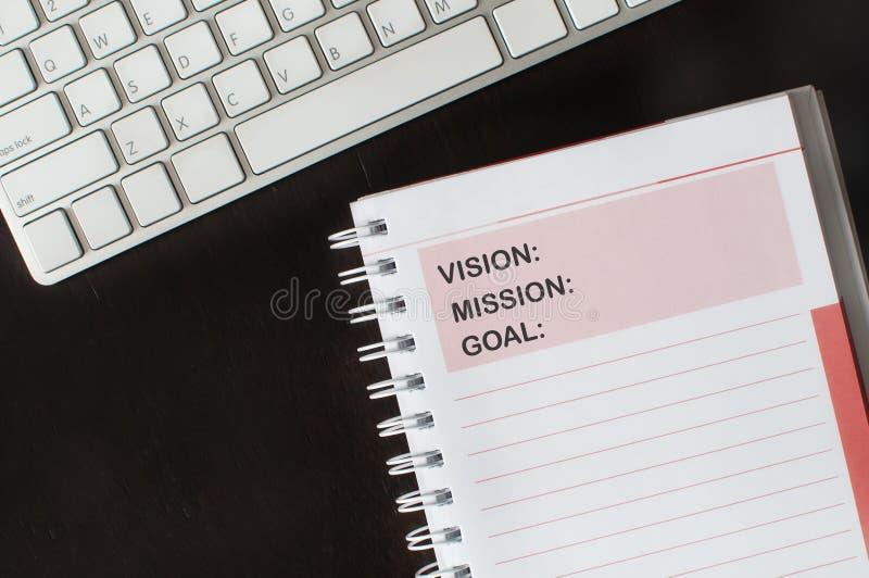 Ord av vision, beskickningen och målet på anmärkningsboken royaltyfri foto