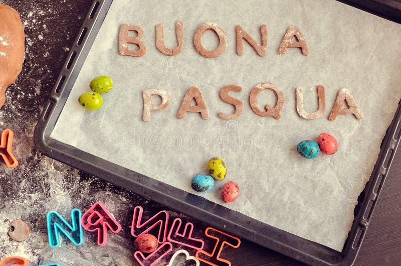 Ord Buona Pasqua som lycklig påsk i italienskt språk arkivfoto