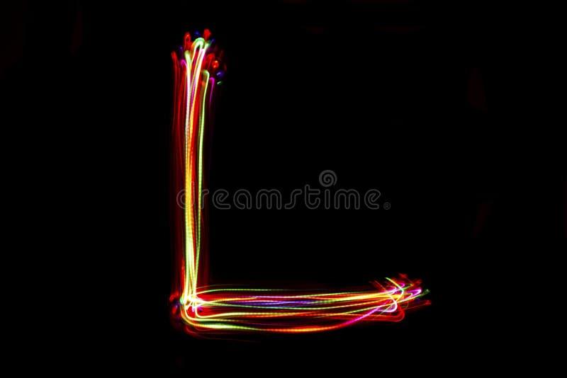 Ord` L `-handstil från ljus royaltyfri fotografi