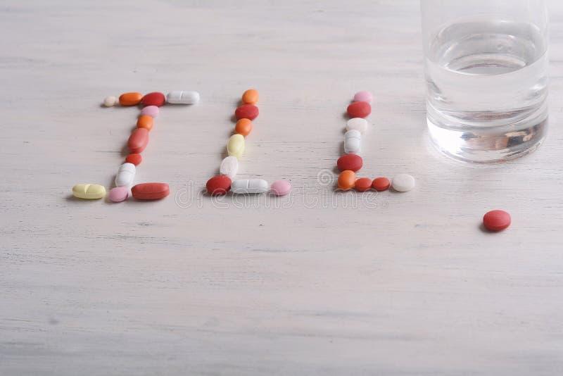 Ord som göras DÅLIGT med preventivpillerar royaltyfri foto