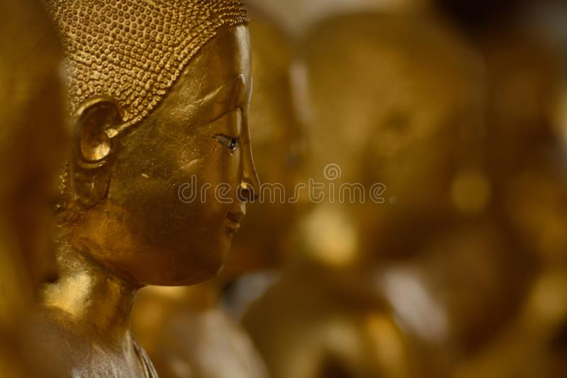 Ordained female monks or Bhikkuni surround Buddha`s sculpture.These are some of the oldest and rarest Bhikkuni statues found in th stock image
