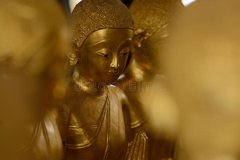 Ordained female monks or Bhikkuni surround Buddha`s sculpture.These are some of the oldest and rarest Bhikkuni statues found in th royalty free stock image